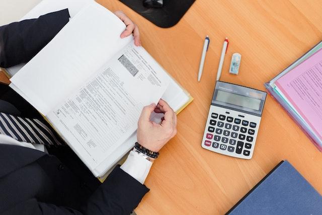 calculator-paperwork