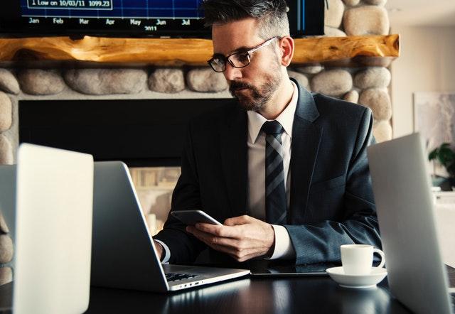 man at computer finances